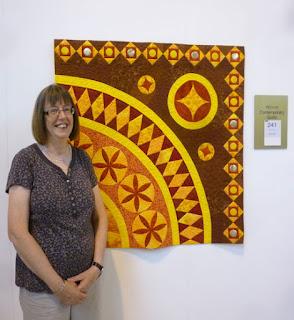 "Linda Bilsborrow with her winning quilt ""Byland Pieces"""